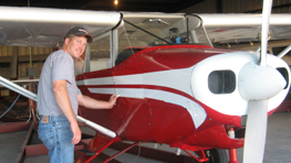 Brian Shaw and a repainted small propellor plane